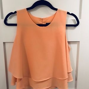 Coral tiered sleeveless blouse